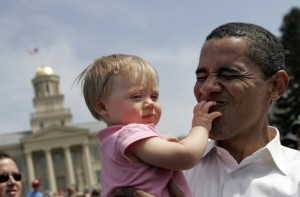 Obama kissing a baby 300x197 Should politicians check in every time they kiss a baby?