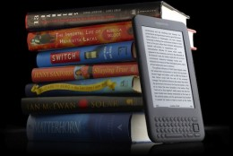 Kindle with books graphite 260x174 Staples To Sell Amazons Kindle