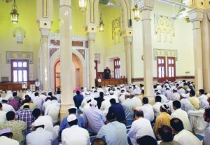 Scene from inside a Mosque with an Imam (usually Muslim Scholar) speaking to the attendees