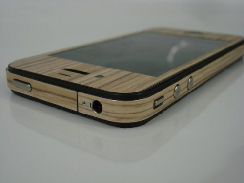 il 570xN.205079378 500x374 Turn your iPhone 4 into a skateboard with grip tape and wood wrap