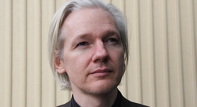 Julian Assange shows up at Occupy London wearing an Anonymous mask