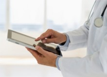 doctor using EHR on ipad