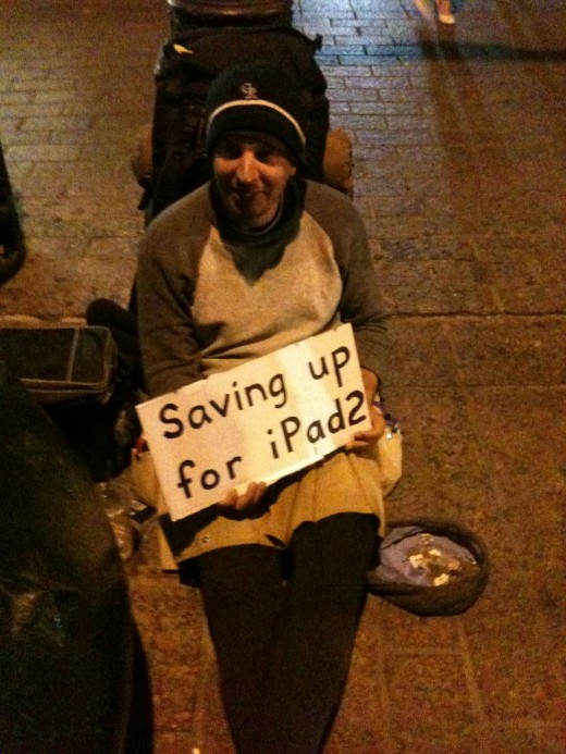 photo 1 520x693 Man panhandling for an iPad 2 at SXSW. Whats the world coming to?