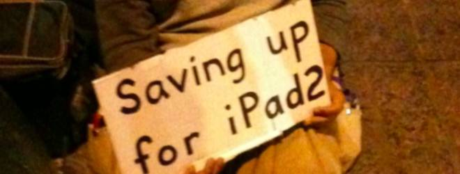 Man panhandling for an iPad 2 at SXSW. What's the world coming to?