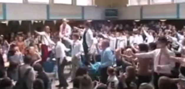 Headmaster and teachers cleverly surprise students with flash mob. Crowd goes wild. [Video]