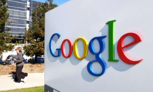 Google net income down as it sets aside $500M for advertising probe