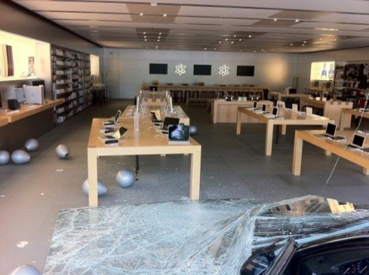 A car crashed into the Apple Store in Greensboro on Friday. The store is closed on Friday 1 520x388 Robber wearing a white ninja suit crashes into Apple Store