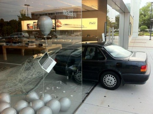 A car crashed into the Apple Store in Greensboro on Friday. The store is closed on Friday 520x388 Robber wearing a white ninja suit crashes into Apple Store