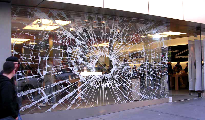 "Robber ""wearing a white ninja suit"" crashes into Apple Store"