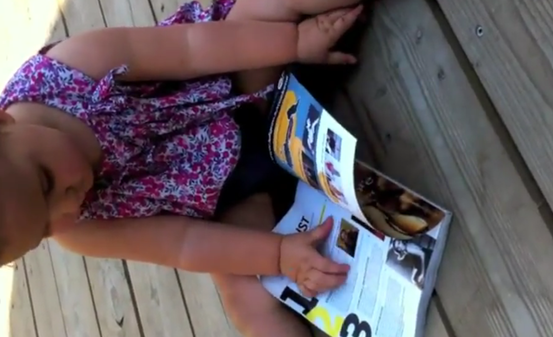 This baby tried to use a glossy magazine like an iPad, and failed