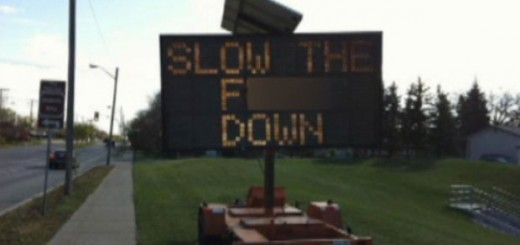 li-slow-down-sign
