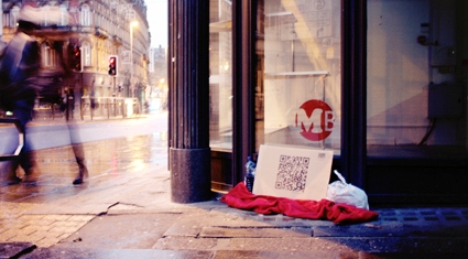 QR codes on cardboard? That's one way to raise money for a UK homeless charity.