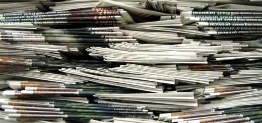 newspaper-stack-520x245
