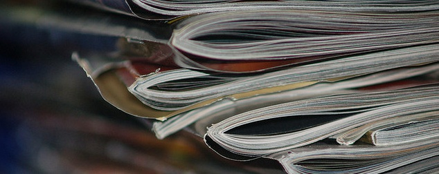 Advertisers are spending way too much on print, too little on mobile
