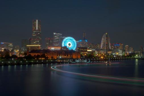 Minato mirai night view with curving ship light trails.