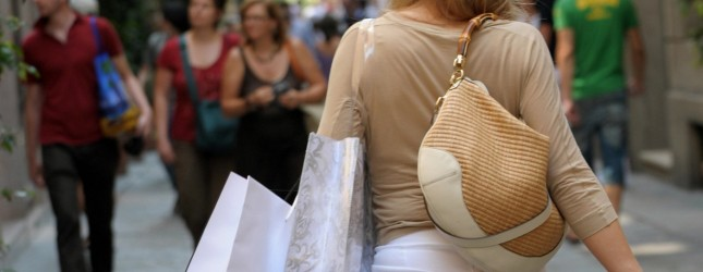 A woman walks with her shopping bags in
