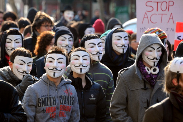 "Anonymous demands free access after Wikileaks adds ""paywall"" for Stratfor Global Information ..."