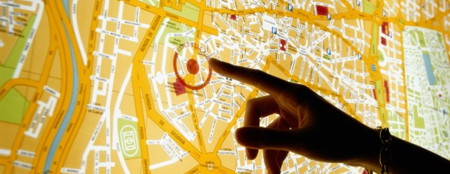 Hand Pointing at Map of Madrid