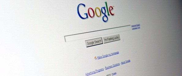 The Google search page appears on a comp