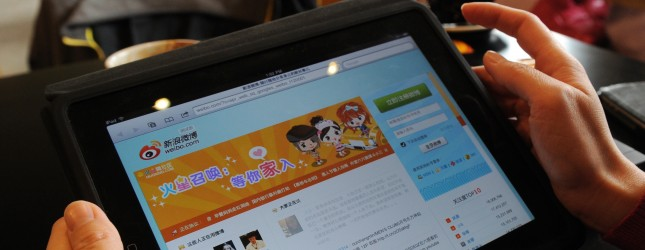 A woman views the Chinese social media w