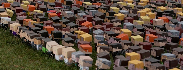 Thousands of tiny cardboard people stage a 'protest' outside the Houses of Parliament in ...