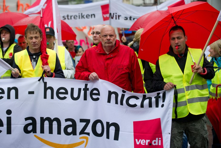 Employees march through Bad Hersfeld, western Germany, on May 14, 2013