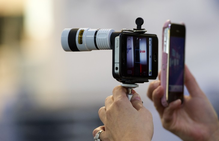 A woman displays a tele adapter for the