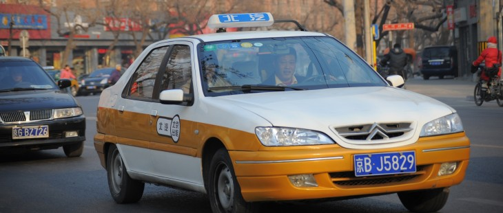 A taxi makes its way along a street in B