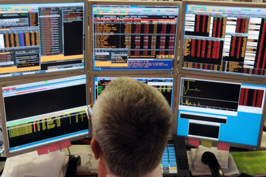 A broker watches screens in an office of