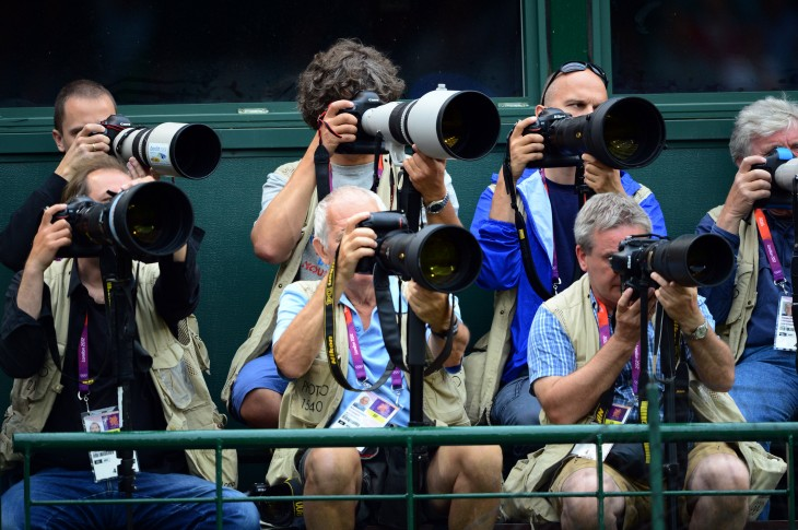 Photographers take images during the wom