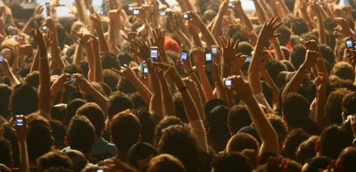 Beirut, LEBANON: Lebanese fans use their mobile phones to take pictures of US rapper 50 Cent during his concert at Biel hall in downtown Beirut late 10 June 2006. AFP PHOTO/NWAR AMRO (Photo credit should read ANWAR AMRO/AFP/Getty Images)
