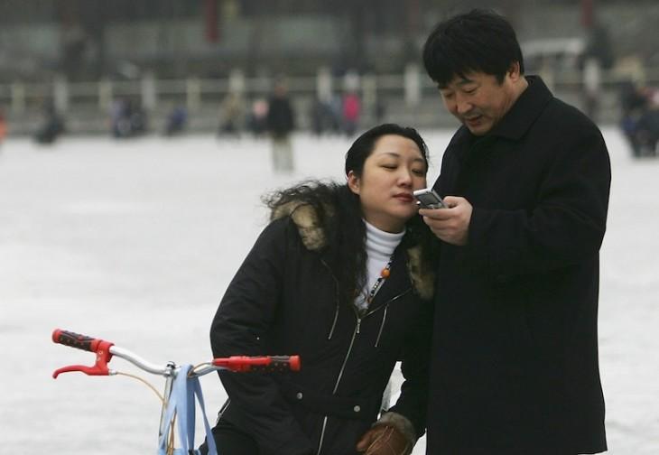 People Play On Frozen Shichahai Lake In Beijing