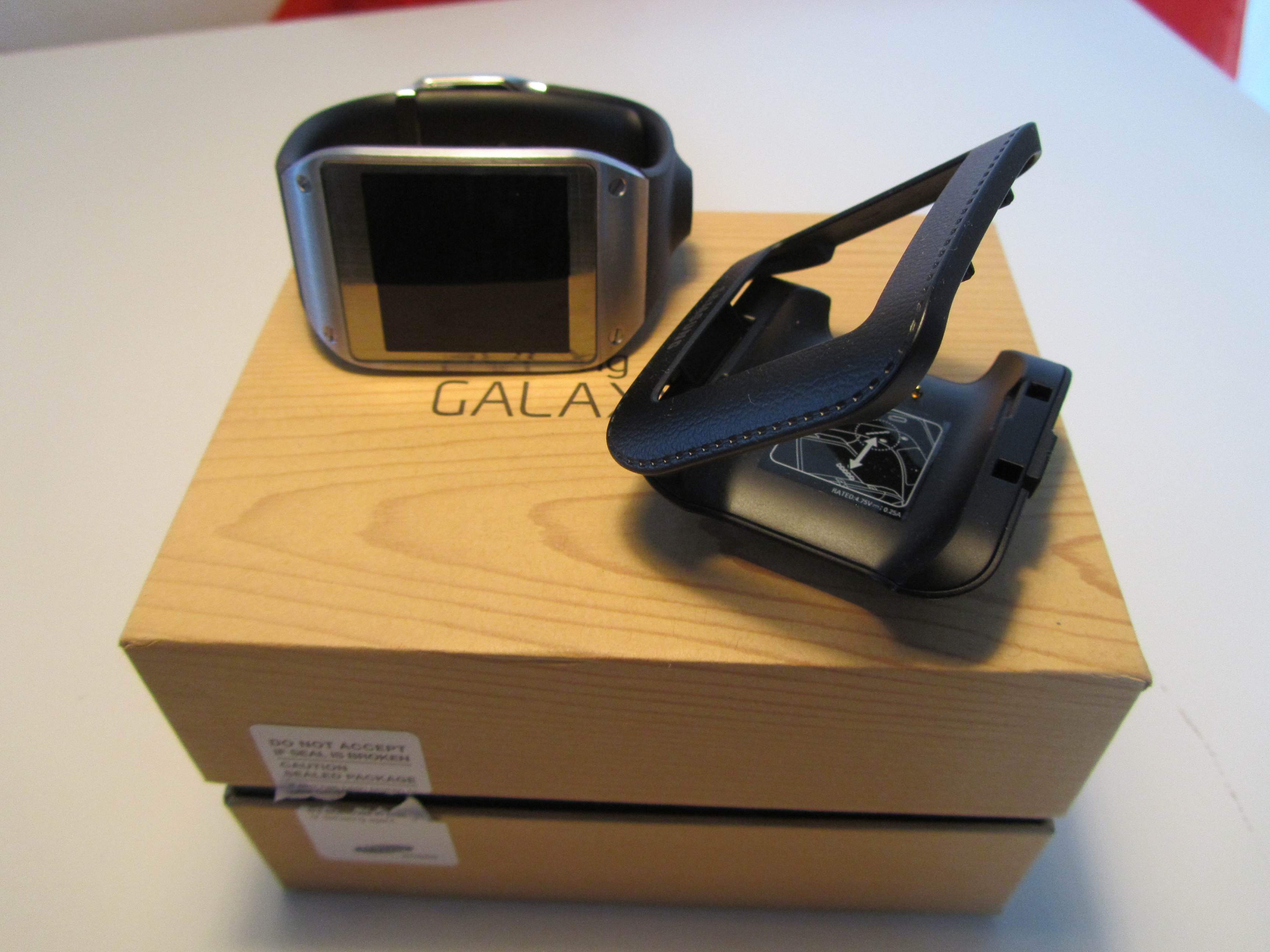 Gear cradle Samsung Galaxy Gear review: A $299 smartwatch that can't send an email…but I hated taking it off