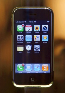 The new Apple iPhone is displayed behind