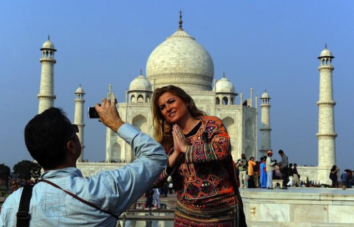 Tourists visit the Taj Mahal in Agra on