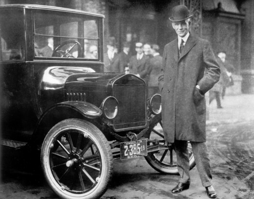 Henry Ford next to a 1921 Model-T