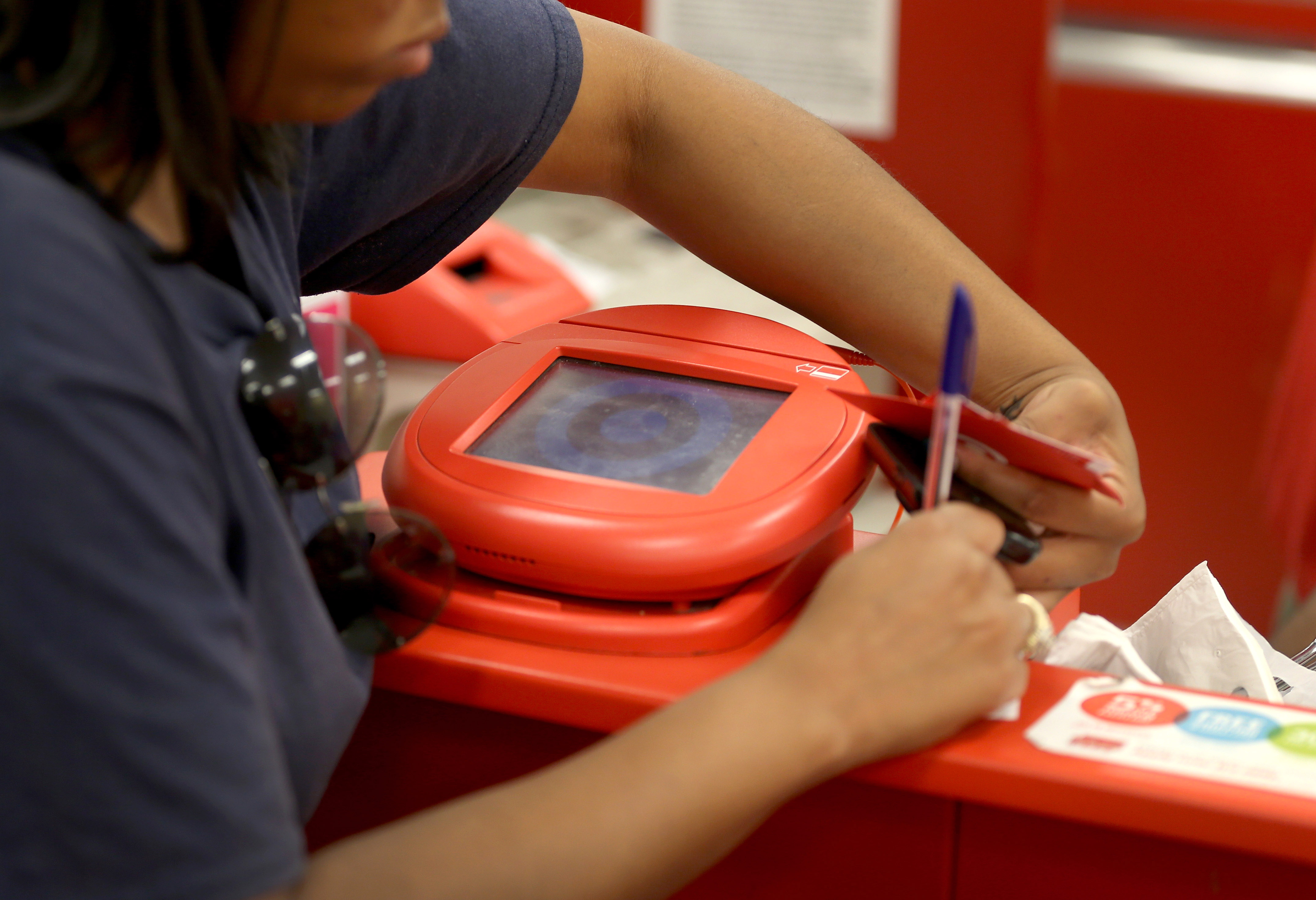 Target confirms debit card PIN info stolen in massive breach, but says data is 'safe and secure'