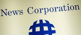 A News Corporation logo adorns the wall,