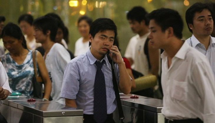 Chinese businessmen leave a crowded subw
