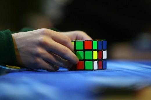 A competitor tries to solve the Rubik cu