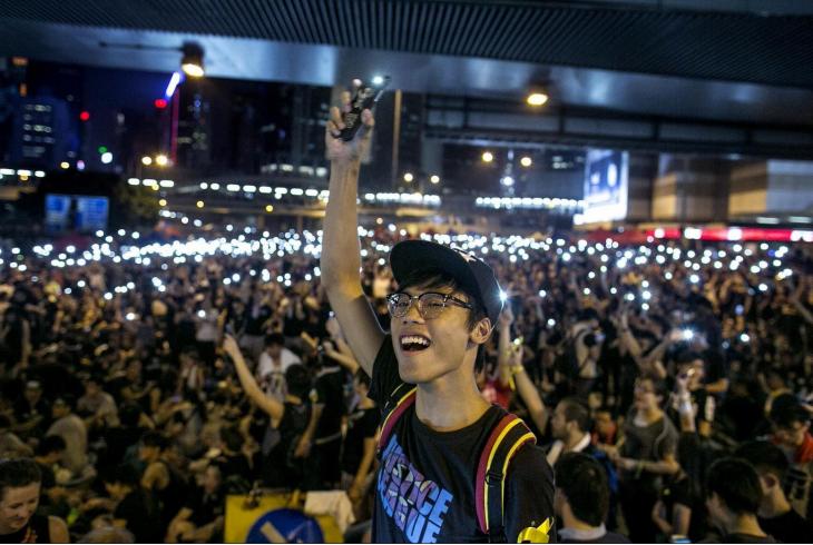 asian man smartphone crowd