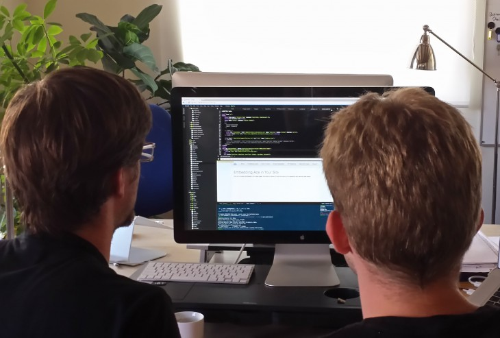 Picture of Cloud9 team members using Cloud9