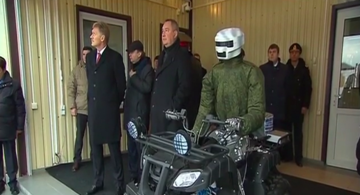 Russian President Vladimir Putin checks out military quad-riding robot