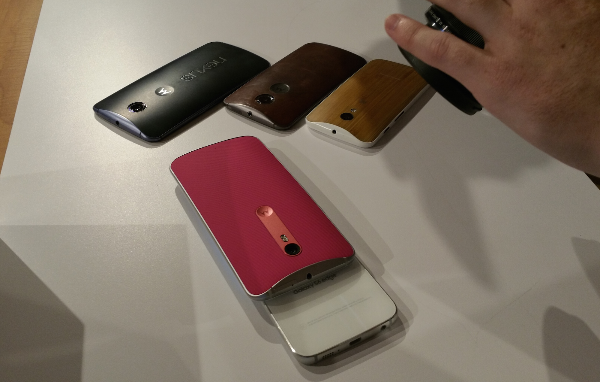 The Moto X Style atop a Samsung Galaxy S6, next to Nexus 6, Moto X (2015) and Moto G