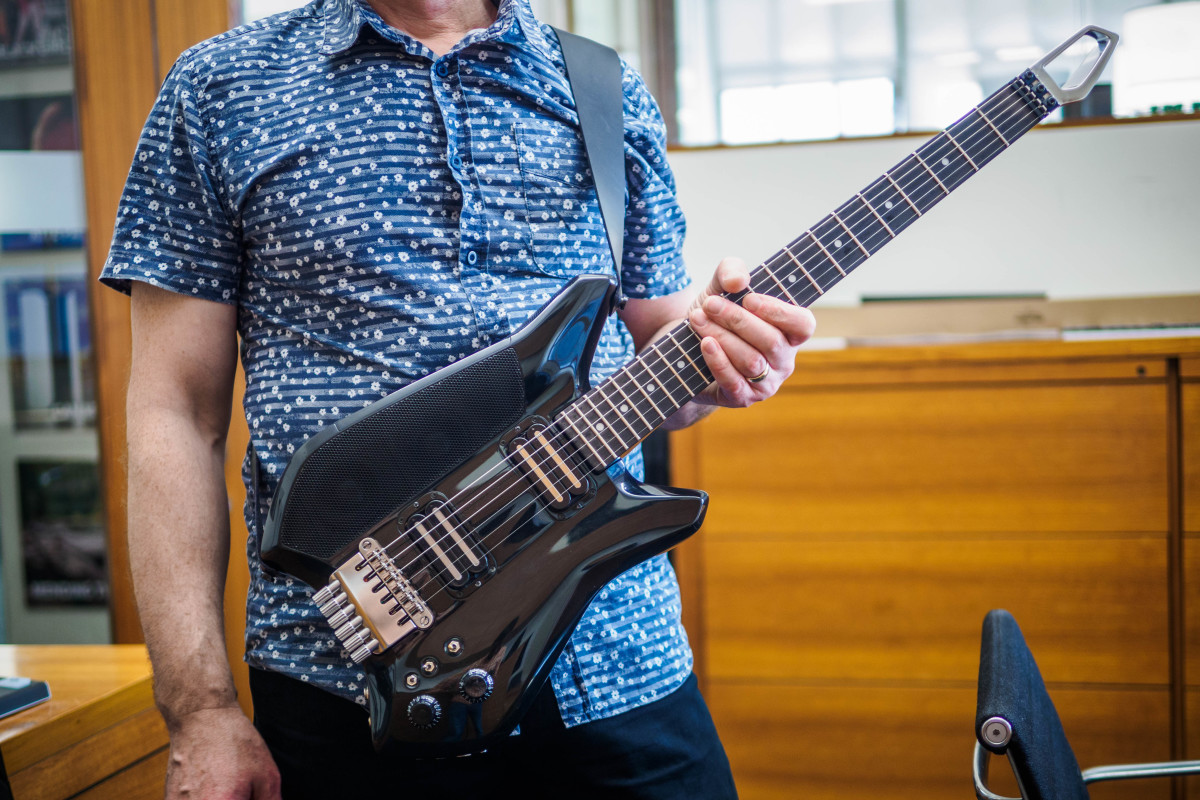 The iPhone-powered Fusion Guitar lets you mix and jam anywhere with a built-in amp