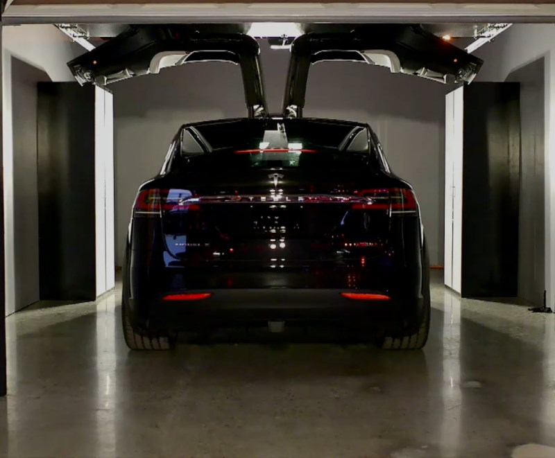 The Model X's rear falcon wing doors sense roof height and adjust to open accordingly