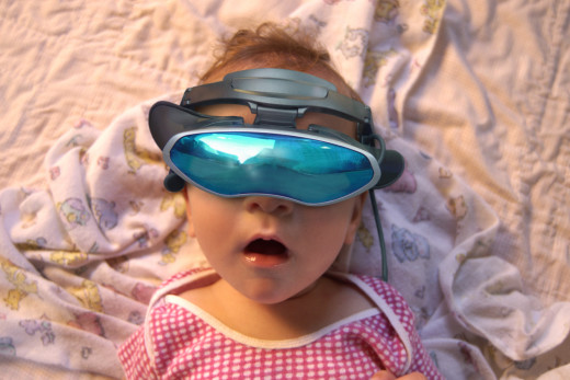 Baby wearing virtual reality goggles