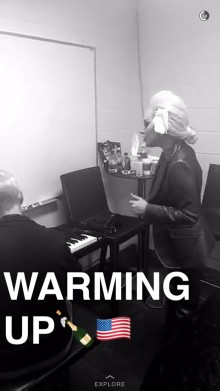 Lady Gaga warming up for her Super Bowl performance, as shown in the Super Bowl story on Snapchat.