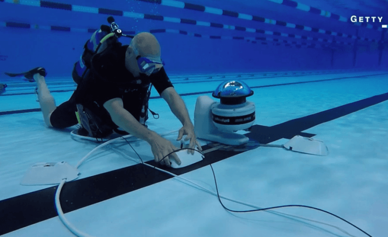 How a robot is helping photographers take the perfect underwater shot at the Olympics
