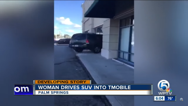 Woman expresses displeasure with T-Mobile's replacement policy by ramming car into store